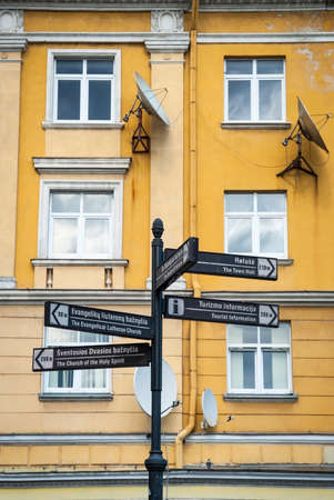 letreros: Black signboards with touristic attractions in Lithuanian street