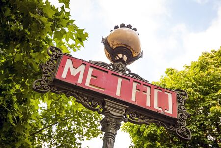 from below: Close-up of old sign for metro station in Paris, France. From below Stock Photo