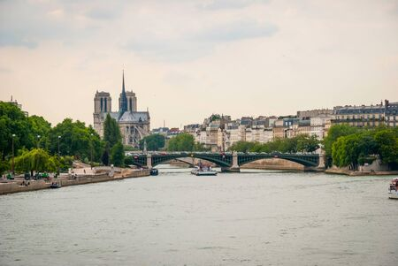 floating bridge: Touristic boats passing on Sienne river in Paris, France