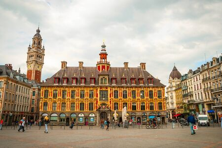 LILLE, FRANCE - JUNE 15: People passing city hall in Central town square, La Grand Place in Lille in afternoon on June 2015 Editorial