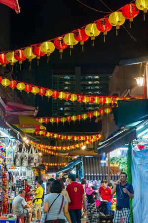 china town: SINGAPORE - APRIL 6: Tourists walking along Singapore china town at night market in April 2016