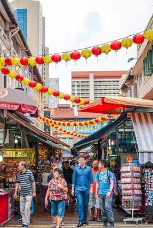 china town: SINGAPORE - APRIL 3: Tourists walking along Singapore china town market Editorial