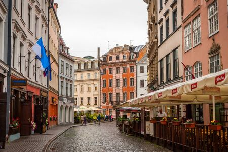 riga: RIGA, LATVIA - 29 JULY: View on Riga downtown with tourists in cafe. July 2015 Editorial