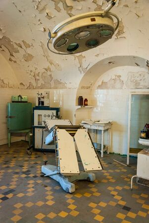 surgery table: View on surgery room interior with operation table in soviet jail in Tallinn, Estonia