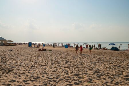 jurmala: People enjoying sunny summer day on sandy beach in Jurmala.