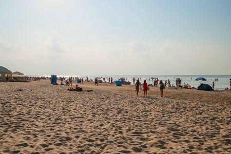 jurmala: People enjoying sunny summer day on sandy beach in Jurmala.