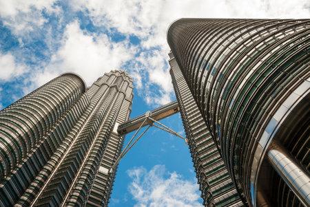 twin tower: View on famous high-rise Petronas twin tower with bridge from below, Kuala Lumpur, Malaysia Editorial