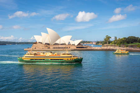 opera house: View on famous Syndey Opera House and ferries in daylight Editorial