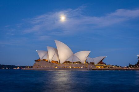 opera house: View on Sydney Opera house with moon at night, long exposure