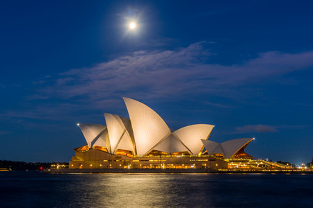 View on Sydney Opera house with moon at night, long exposure