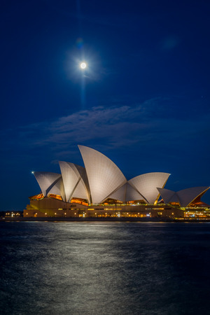 sydney opera house: View on Sydney Opera house with moon at night, long exposure