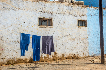 clothespegs: Blue laundry drying outside on the rope Turpan Xinjiang China Stock Photo