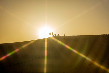 Silhouette of people on the top of sand dunes Gobi desert China