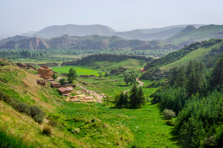 Green landscape and mountains surrounding Mati si temple Gansu Province China