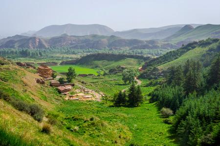 surrounding: Green landscape and mountains surrounding Mati si temple Gansu Province China