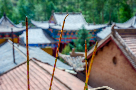 hoof: Incense sticks in front of the roofs of Horses Hoof temple Mati si cave temple Zhangye Gansu province China
