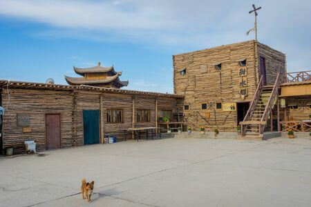 touristic: Buildings and village for backdrop scenery for movie set Dunhuang China