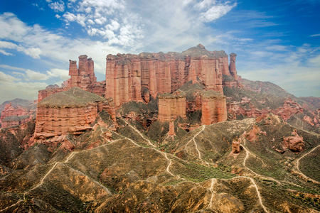 Walking paths around sandstone rock formation at Zhangye Danxia National Geological Park Gansu Province China Imagens - 66118030