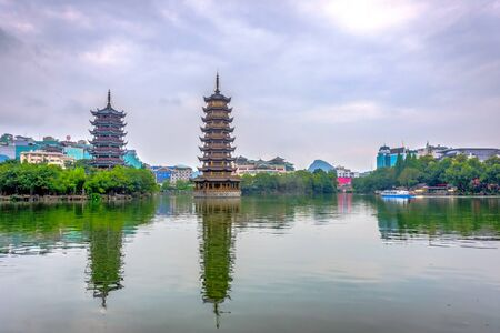 Two towers pagodas of Sun and Moon by the lake. Top tourist attraction in Guilin China Stock Photo
