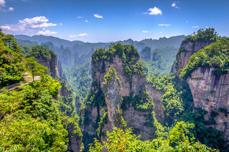 View over tall sandstone columns and formations in Zhangjiajie national park Hunan China. HDR image
