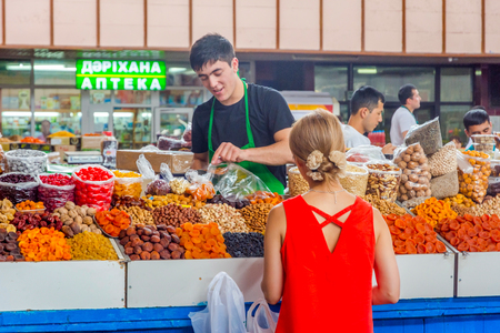 ALMATY, KAZAKHSTAN - JULY 15: People selling and buying dry fruits and nuts at Green bazaar. July 2016 Editorial