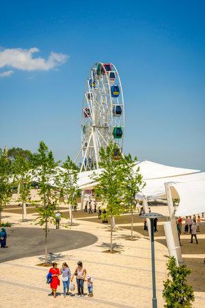 ALMATY, KAZAKHSTAN - JULY 16: People enjoying sunny day in Kok Tobe amusement park in Almaty. July 2016