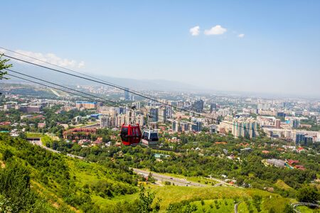 View over Almaty skyline and cable car, Kazakhstan Stock Photo