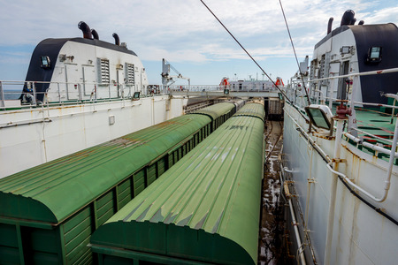 train loaded on the cargo vessel on the sea