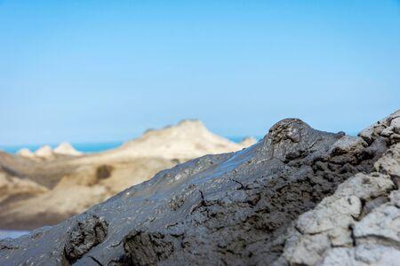 erupting: Mud volcano erupting mud, Gobustan park, Azerbaijan Stock Photo