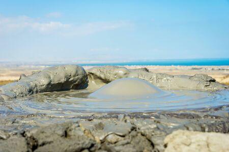 Mud volcano erupting mud bubble, Gobustan, Azerbaijan