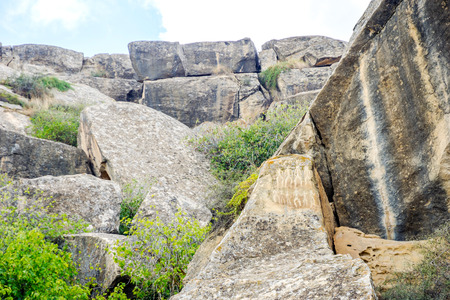 Ancient petroglyph drawings on the rocks in Gobustan, Azerbaijan Stock Photo