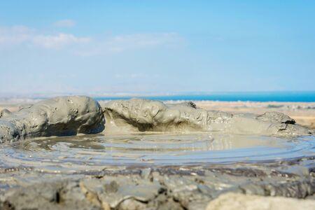 erupting: Mud volcano erupting mud bubble, Gobustan, Azerbaijan