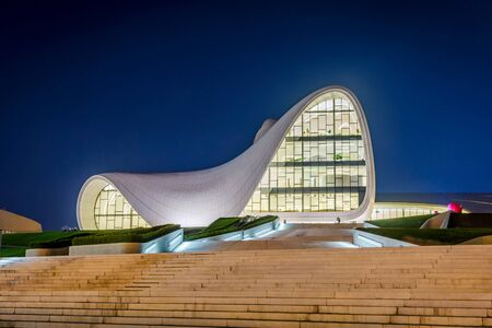 azeri: BAKU, AZERBAIJAN - SEPTEMBER 22: Heydar Aliyev center at night designed by Zaha Hadid. Center houses a conference hall, a gallery and a museum. September 2016