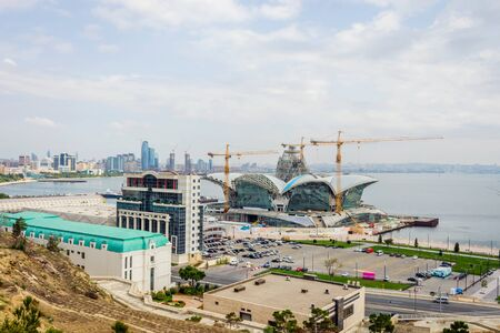 azeri: BAKU, AZERBAIJAN - SEPTEMBER 23: Caspian Waterfront shopping mall under construction, Baku. September 2017