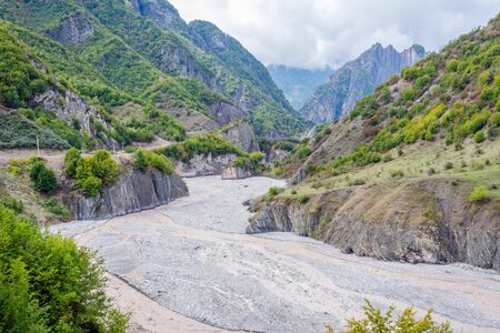 View over Lahich river bed torrent and vertical rocks in summer, Azerbaijan