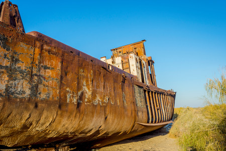 desolacion: Old ships in the desert ship cemetery the consequence of Aral sea disaster, Muynak, Uzbekistan Foto de archivo