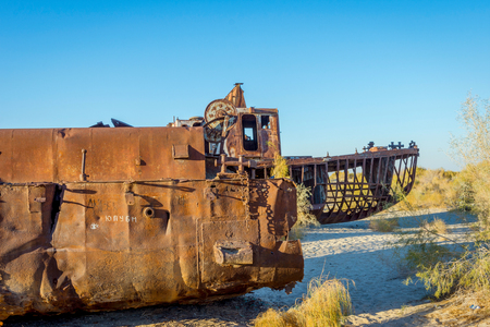 Old ships in the desert ship cemetery the consequence of Aral sea disaster, Muynak, Uzbekistan Stock Photo
