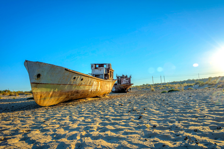 consequence: Old ships in the desert ship cemetery the consequence of Aral sea disaster, Muynak, Uzbekistan Editorial