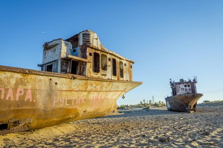 ship wreck: Old ships in the desert ship cemetery the consequence of Aral sea disaster, Muynak, Uzbekistan Stock Photo