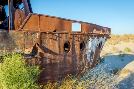 scrapyard: Old ships in the desert ship cemetery the consequence of Aral sea disaster, Muynak, Uzbekistan Stock Photo