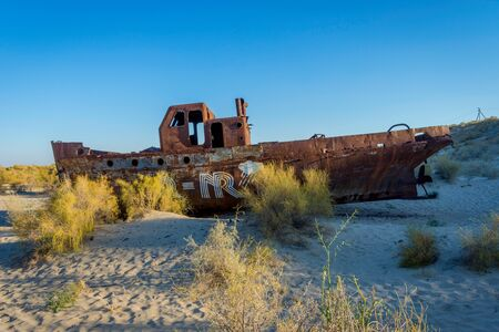 Old ships in the desert ship cemetery the consequence of Aral sea disaster, Muynak, Uzbekistan Editorial