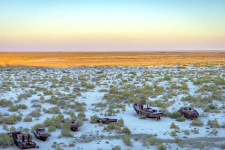 Old ships in the desert ship cemetery the consequence of Aral sea disaster, Muynak, Uzbekistan Reklamní fotografie