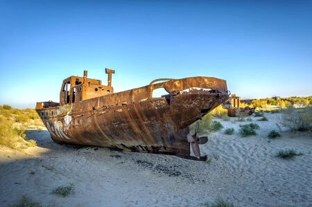 ship wreck: Old ships in the desert ship cemetery the consequence of Aral sea disaster, Muynak, Uzbekistan Editorial
