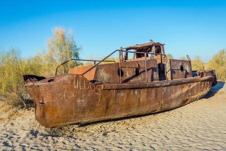 scrapyard: View over old rusted vessel at the aral sea ship cemetery, Muynak, Uzbekistan