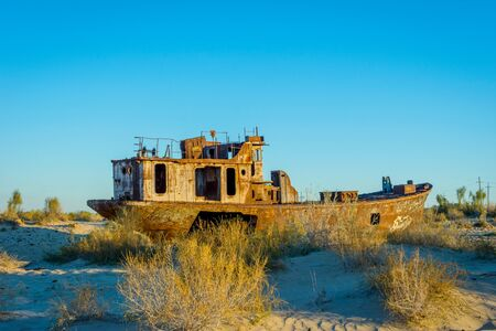 desolacion: View over old rusted vessel at the aral sea ship cemetery, Muynak, Uzbekistan