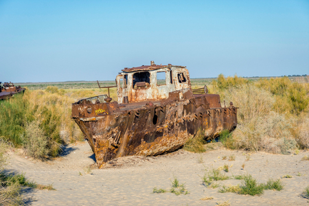 View over old rusted vessel at the aral sea ship cemetery, Muynak, Uzbekistan