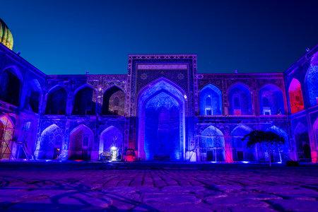 Illuminated colorful atrium of Sher-Dor Madrasah at night, Samarkand Registan, Uzbekistan Editorial