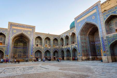 registan: SAMARKAND, UZBEKISTAN - AUGUST 27: Visitors at the atrium of the Sher-Dor Madrassah in Registan,  Samarkand. August 2016 Editorial