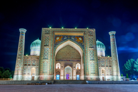 registan: Illuminated Sher-Dor Madrasah at night, Samarkand Registan, Uzbekistan