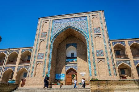 TASHKENT, UZBEKISTAN - AUGUST 24: People at the entrance to the Madrasah at Chorsu bazaar. August 2016